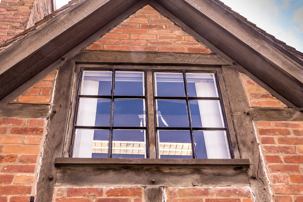 Timber-frame with brick infill